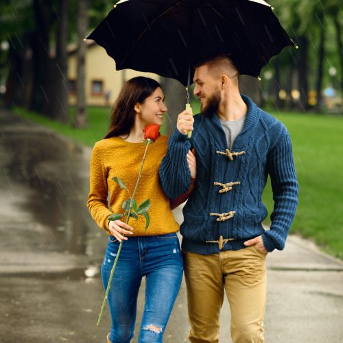 romantic-couple-with-umbrella-walking-in-park.jpg
